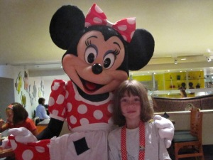 My daughter at Chef Mickey's with Minnie Mouse
