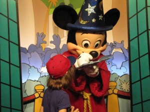 My daughter meeting Sorcerer Mickey in the Animation Studio.