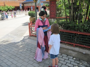 My daughter with Mulan in the China Pavilion.