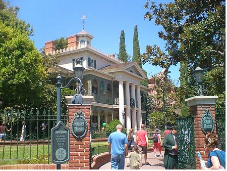 Guests entering the original Haunted Mansion at Disneyland (photo courtesy of theme park insider)